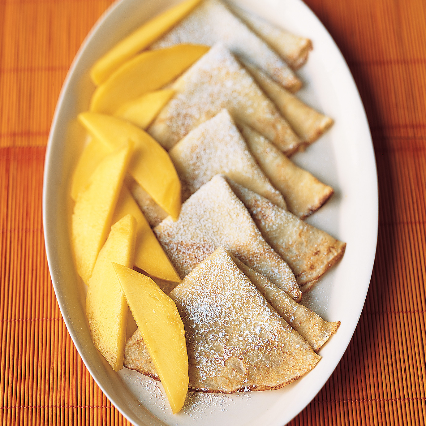 Coconut Crepes with Fresh Mangoes
