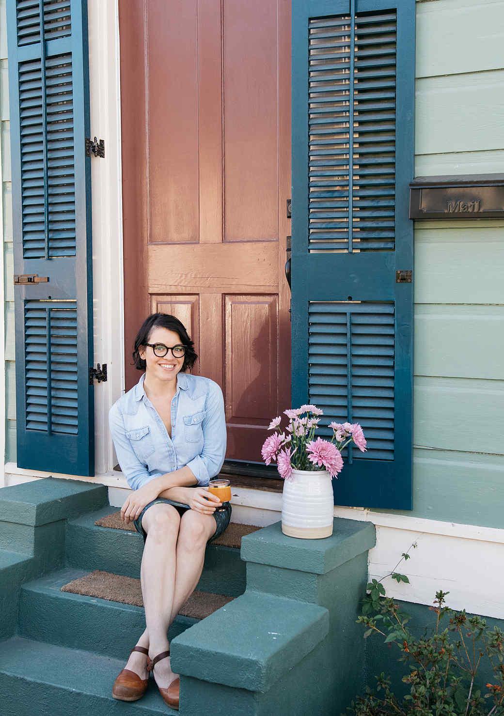 joy the baker sitting on steps front stoop