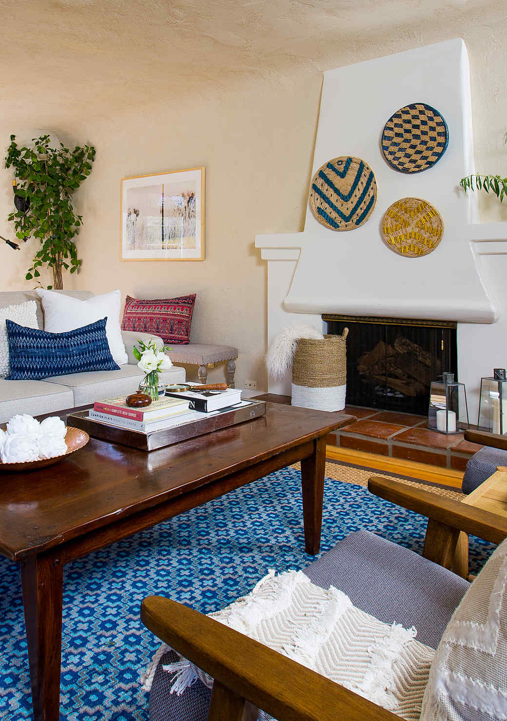 living room woven plate mantel display blue rug