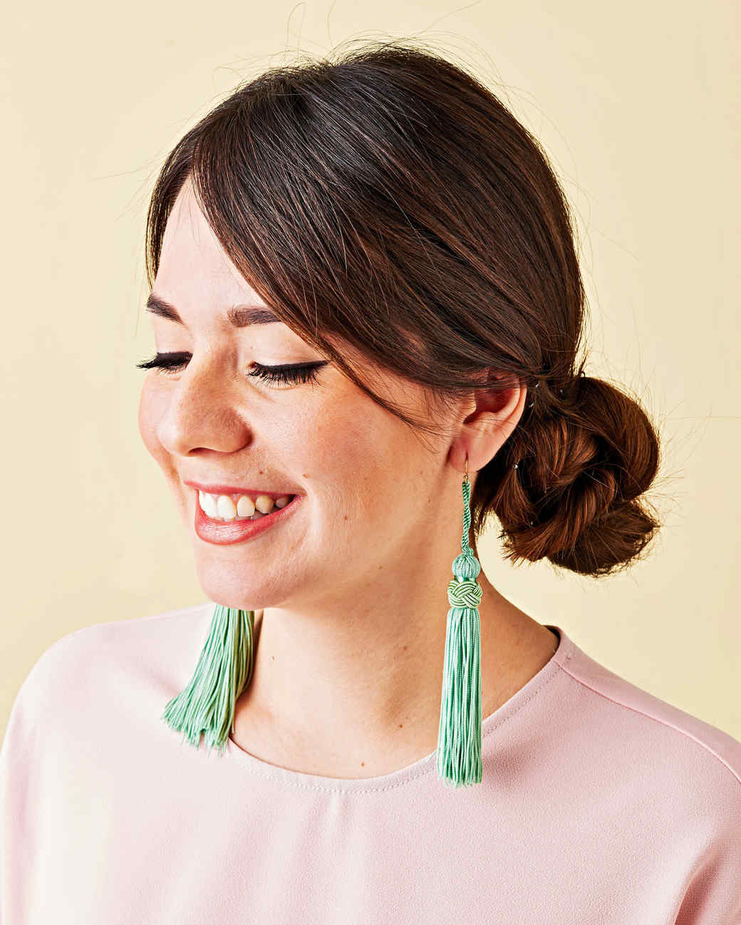 green fringe earrings on woman