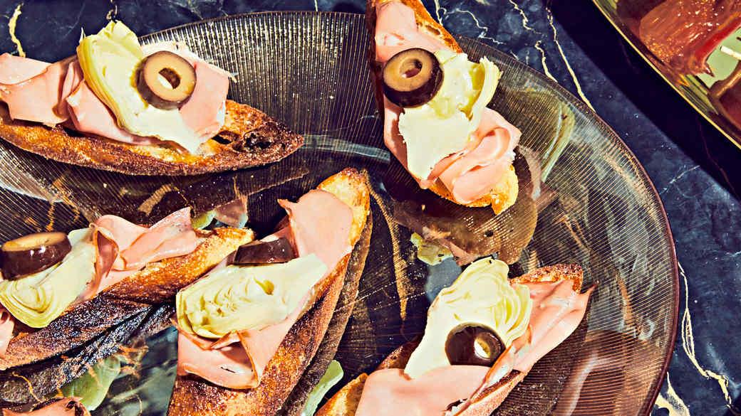 Mortadella, Artichoke-Heart, and Olive Crostini