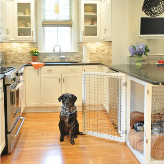 This dog house is built into the counter space of the kitchen.