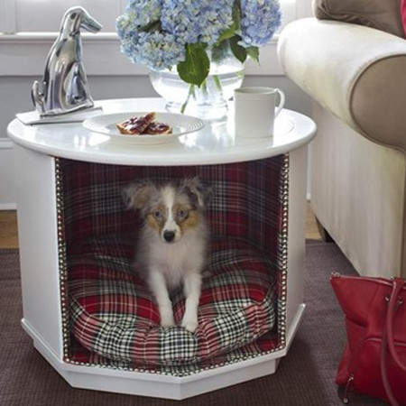 This indoor dog house is built into a side table.