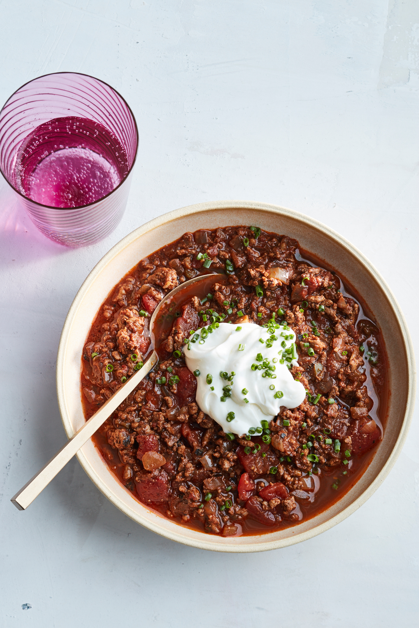 easy beef chili with sour cream in bowl