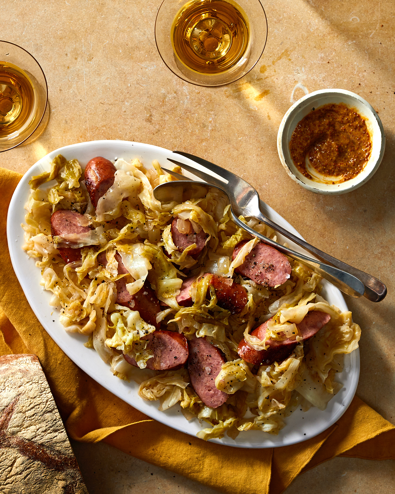 fried cabbage with sausage on orange table