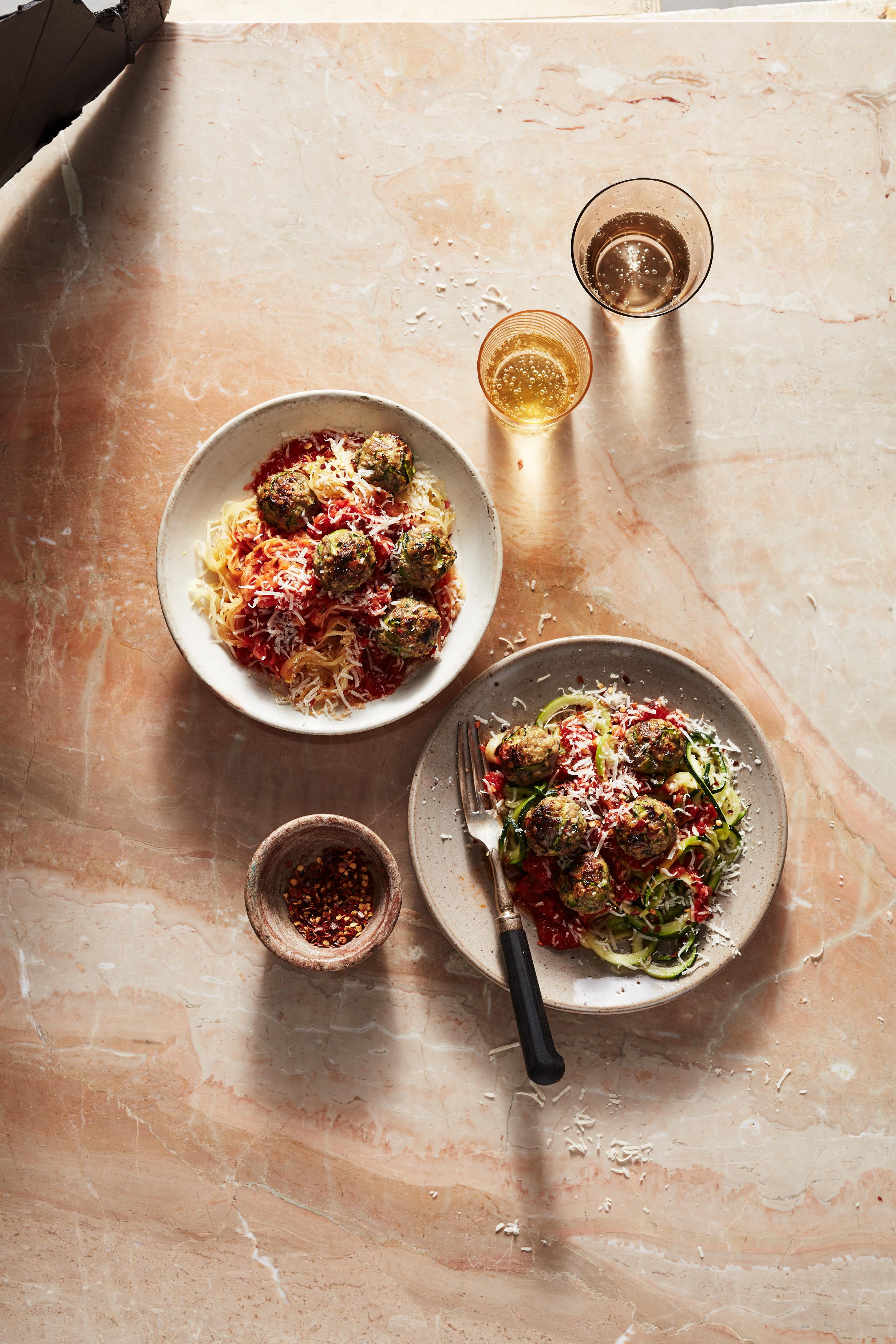 bowls of spaghetti squash and zucchini noodles with zucchini meatballs