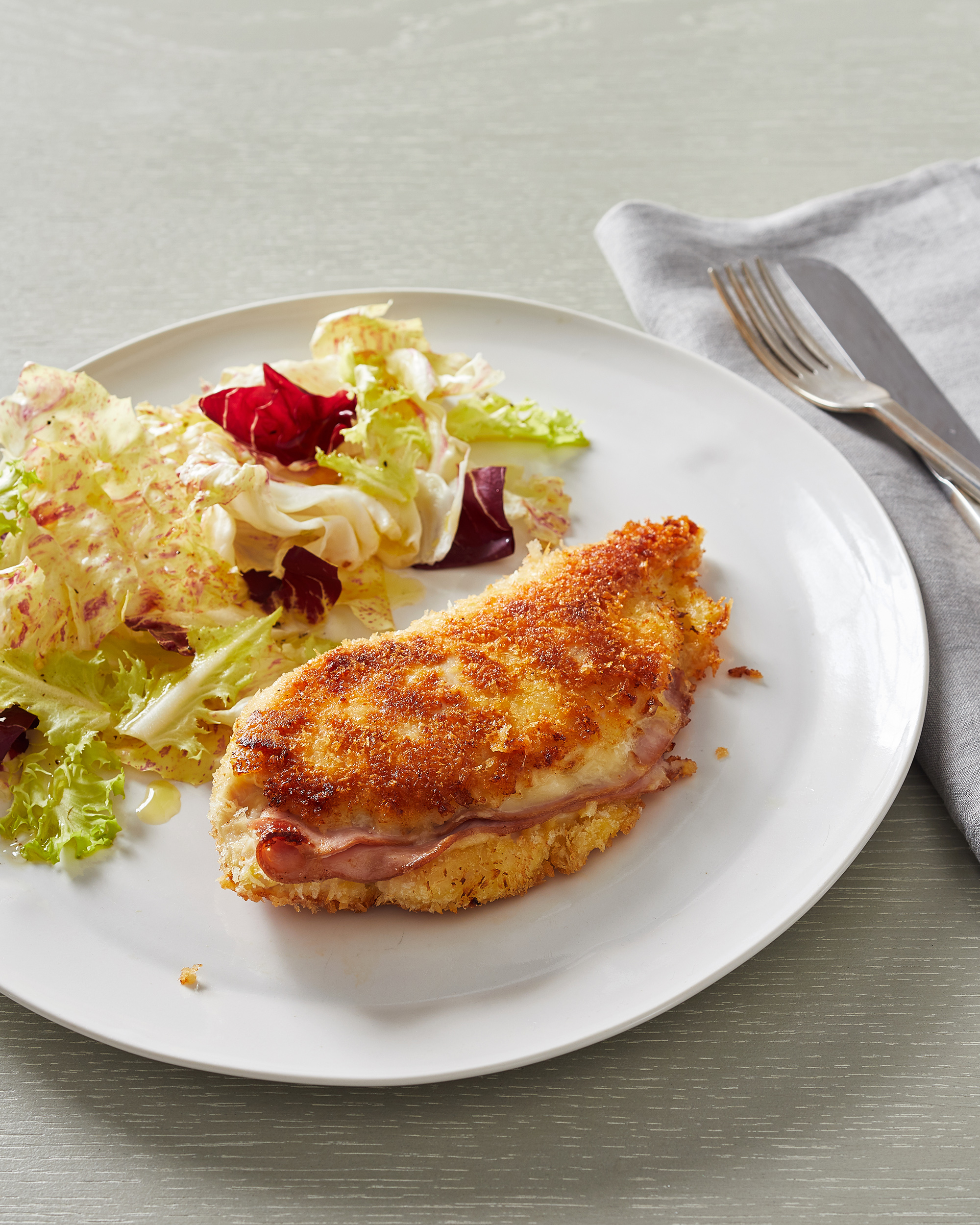 chicken cordon bleu on white plate