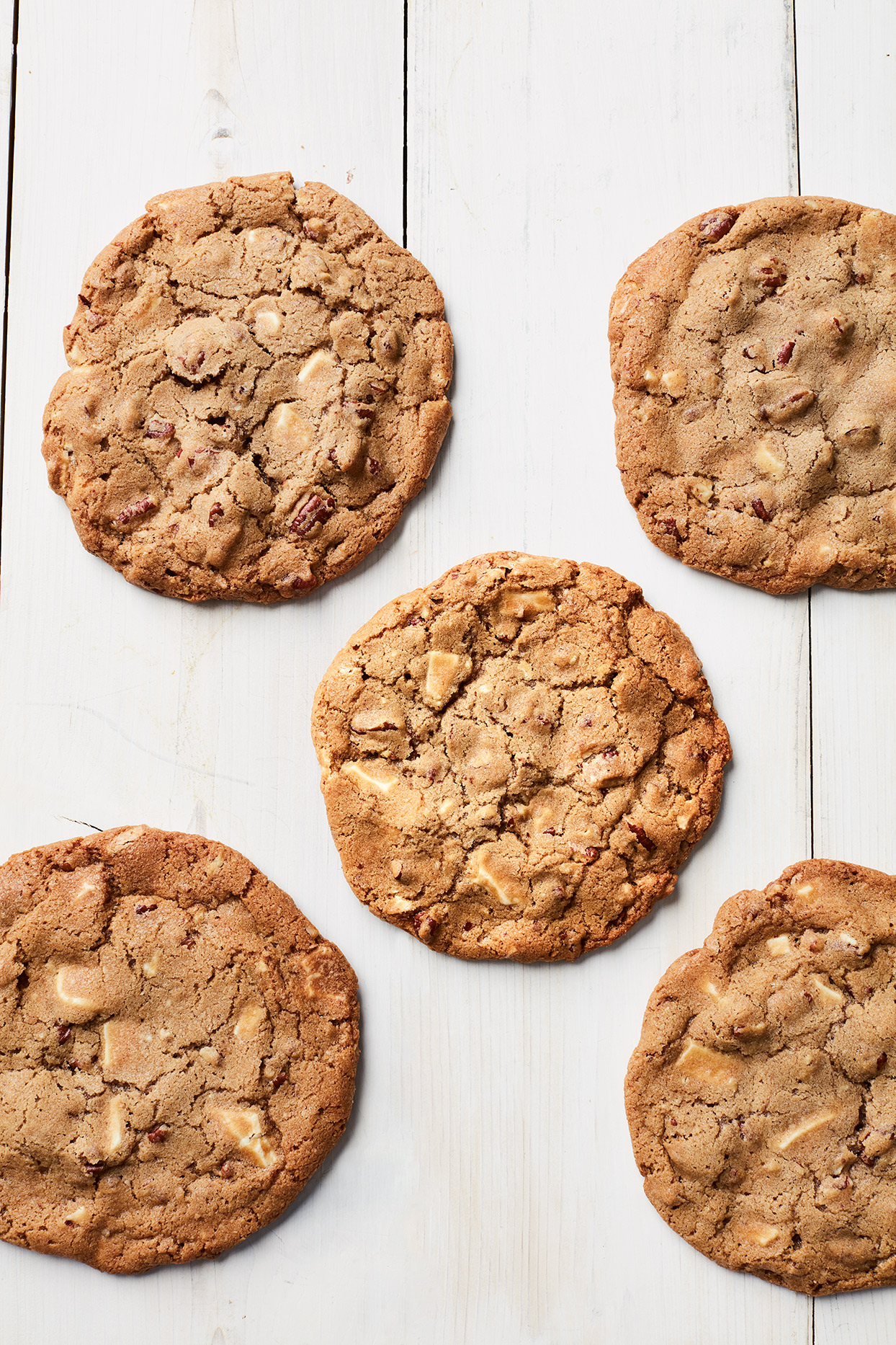 giant white-chocolate-pecan cookies against a white background