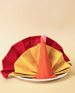 turkey folded red yellow napkins on plate