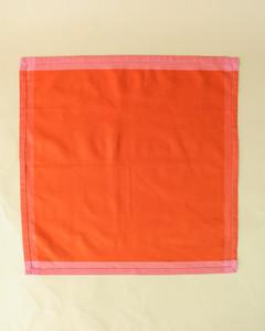 turkey unfolded orange napkin step one
