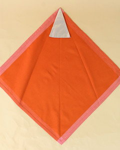 turkey unfolded small piece line indents orange napkin step five