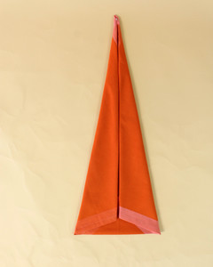 turkey thin triangle fold orange napkin step nine