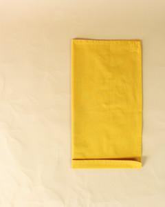 turkey half folded bottom fold yellow napkin step thirteen