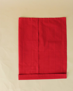 turkey left bottom side fold red napkin step sixteen