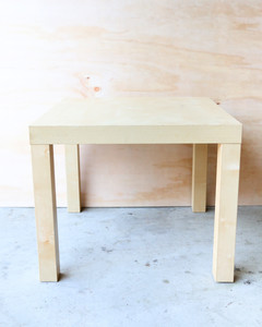 four-leg wooden table on concrete
