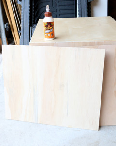 wooden slab next to table with wood glue
