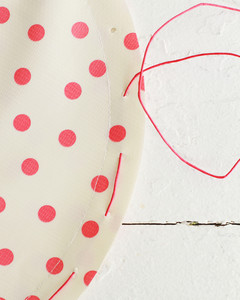 stringing through holes on polka dot travel dog bowl