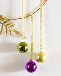 ornaments on ribbon for a Mardi Gras wreath