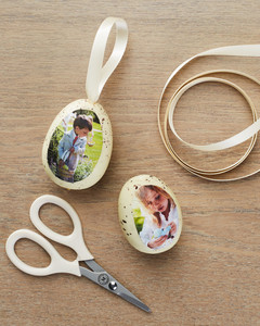 attaching looped ribbon to eggs with photographs