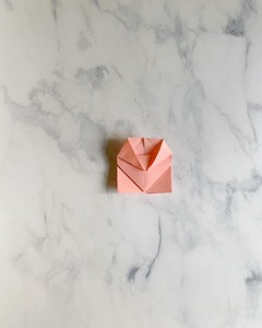 folding a paper origami heart