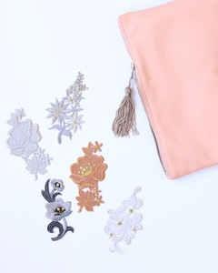iron-on applique leather clutch