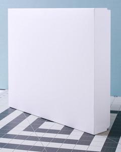 white rectangular box atop cutting mat