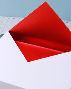 envelope valentine box with red lining and creased lid