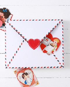 vintage valentines atop envelope valentine box