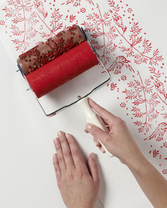 holiday project pattern roller wrapping applying paint to paper