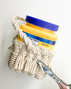 Trim away each cord as close to where it exits the basket as possible.
