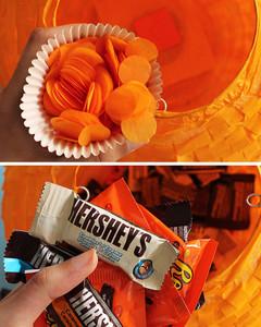 halloween pumpkin pinata adding confetti and candy