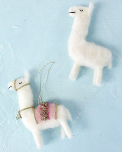 needle felted llama ornaments completed with pink ribbon