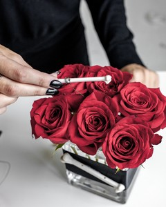 bone placing roses centerpiece