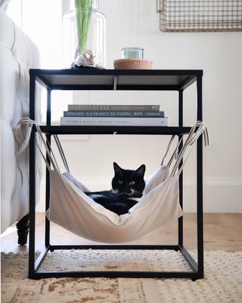 close up diy cat hammock with cat peeking out