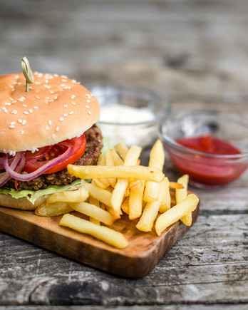 Grilled Hamburger with Fries and Condiments