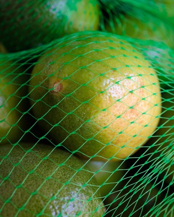 limes in a mesh bag
