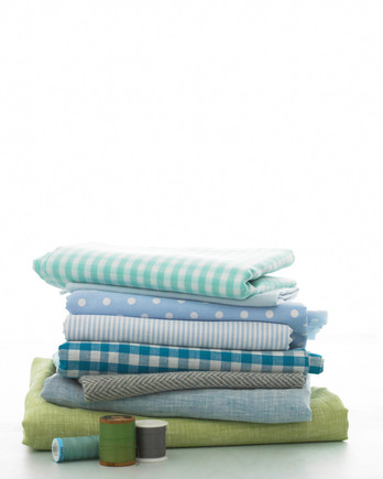 folded pile of blue and green fabric