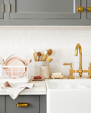 kitchen sink with gold faucet