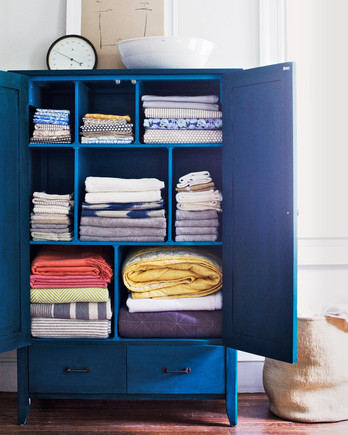 blue armoire storing linens