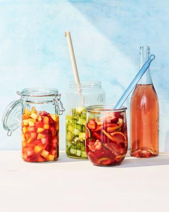 red pink white sangria jars drinks fruit