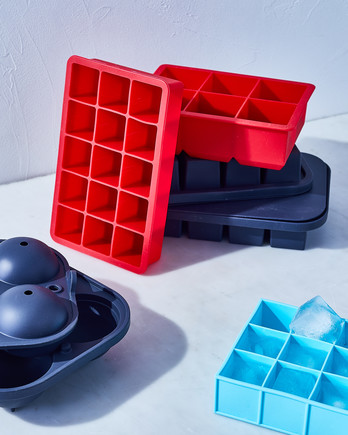 red and blue ice cube trays stacked