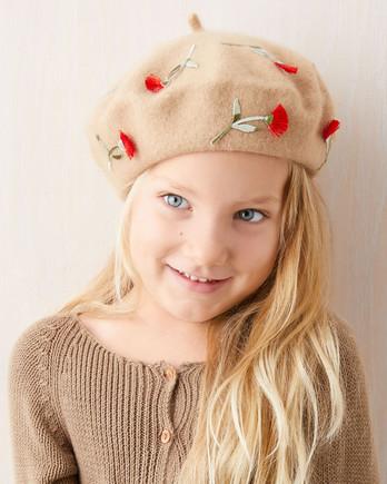 girl in floral applique beret