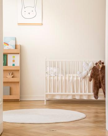 Open doors looking into baby nursery