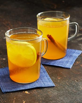 bourbon hot toddies with cinnamon and lemon