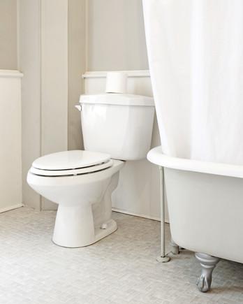 white bathroom interior with clawfoot tub