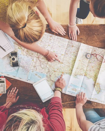 women looking at map and planning trip