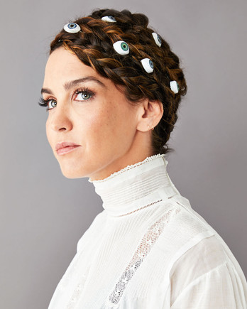 braided hair updo with doll eyes