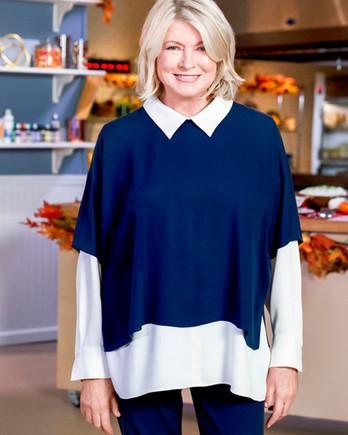 martha stewart posed on set with kitchen in background