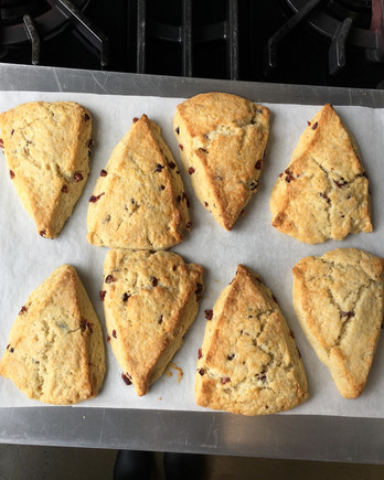 scones on baking sheet atop stove