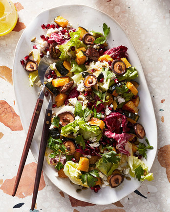 chopped winter salad with mushrooms and pomegranate
